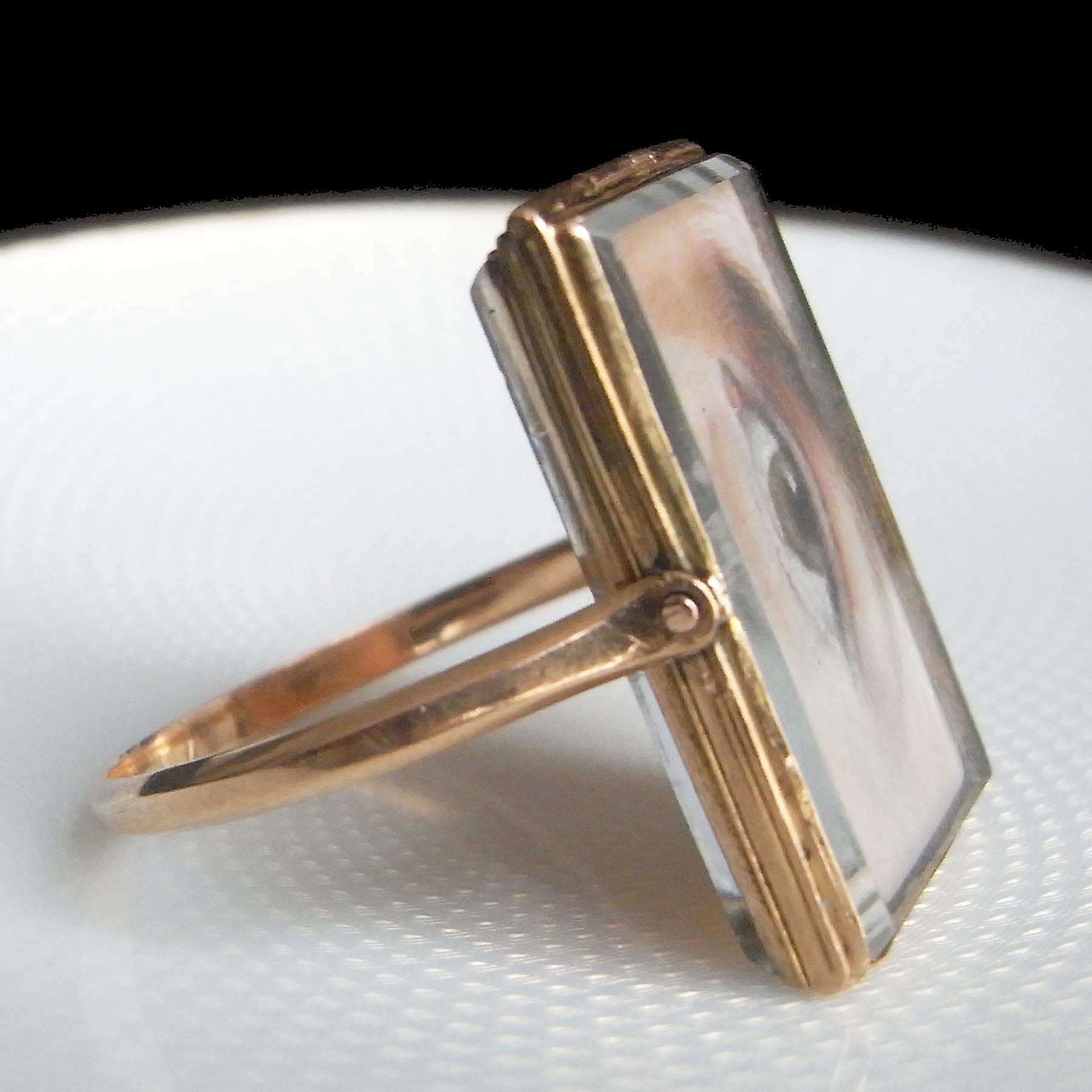 ダブルフェイスのアンティークジュエリーの指輪
